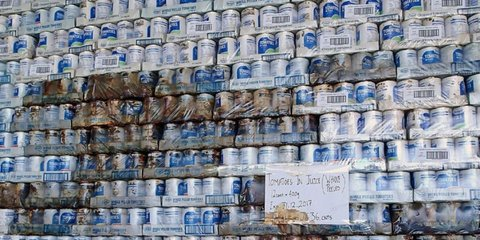 Boxes of canned goods languish in a warehouse