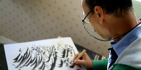 Sayed Ali Karam Jawhary practicing his calligraphy