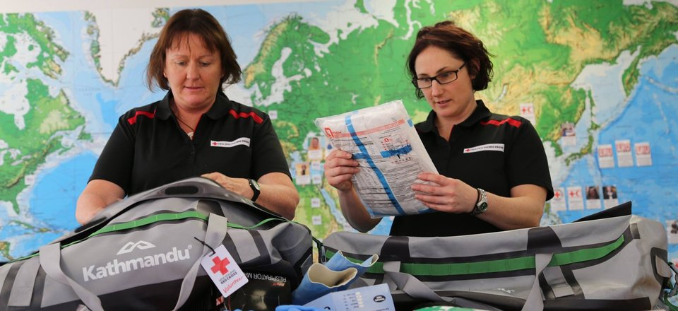 Red Cross staff sort equipment from a corporate partner