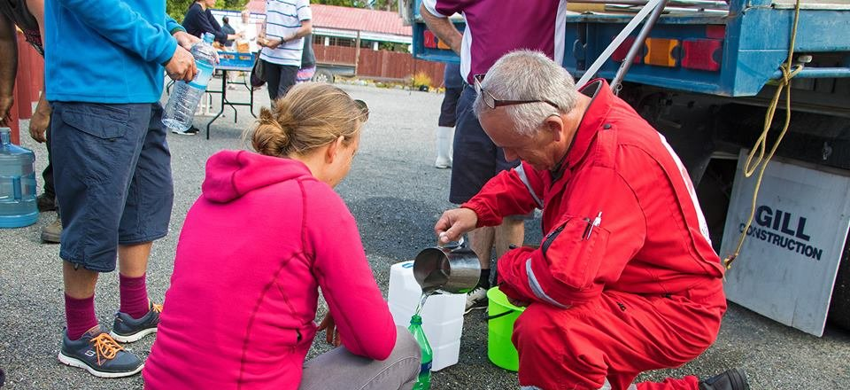 A DWST member provides a Kaikoura resident with clean water.
