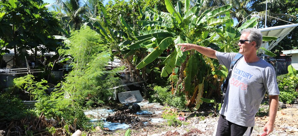 Peter Scott, pointing out areas of concern following Cyclone Pam in Tuvalu (2015)
