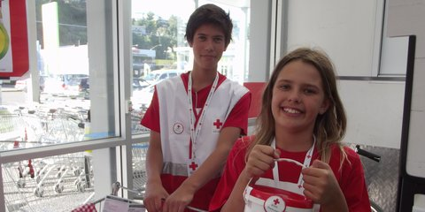 Young Red Cross supporters help collect during a Red Cross street appeal