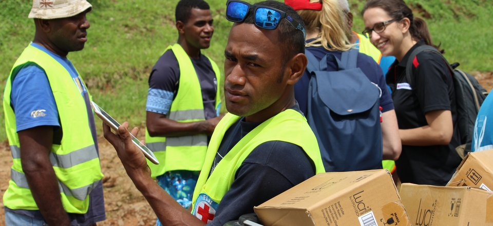 Red Cross unload aid parcels in the Pacific