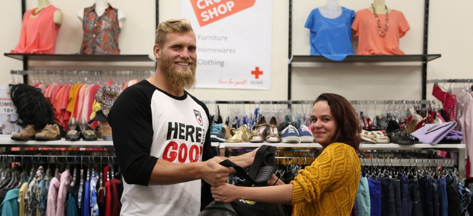 Hurricanes player Brad Shields donates goods at a Red Cross shop