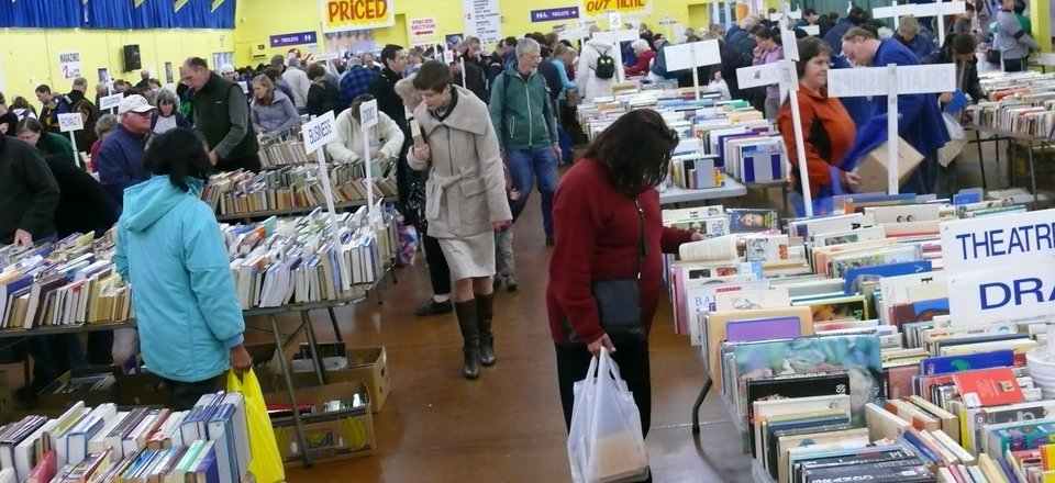 Customers browse at a Red Cross book fair