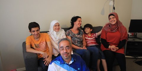 Marcia, refugee support volunteer, and the Loulou family