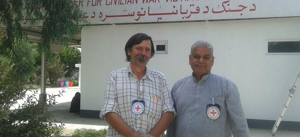 Rolands Selis, with a colleague from a nearby hospital, outside the Civilian Emergency Hospital in Lashkargar