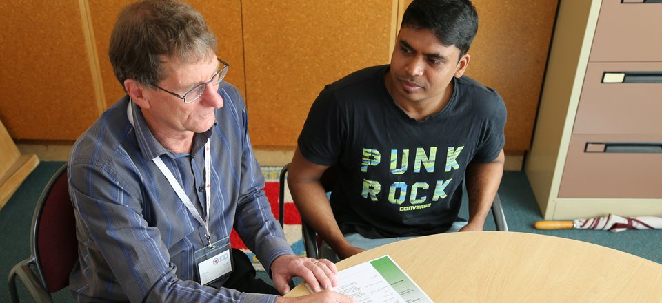 Pathways to Employment client Thass meets with employment liaison Alan