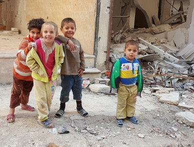 Children play in Syria